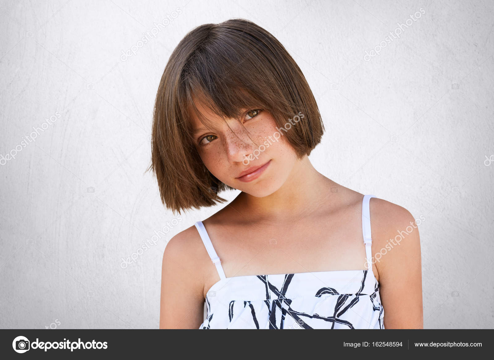 Pretty Little Girl With Freckles Dark Eyes And Short Hairstyle