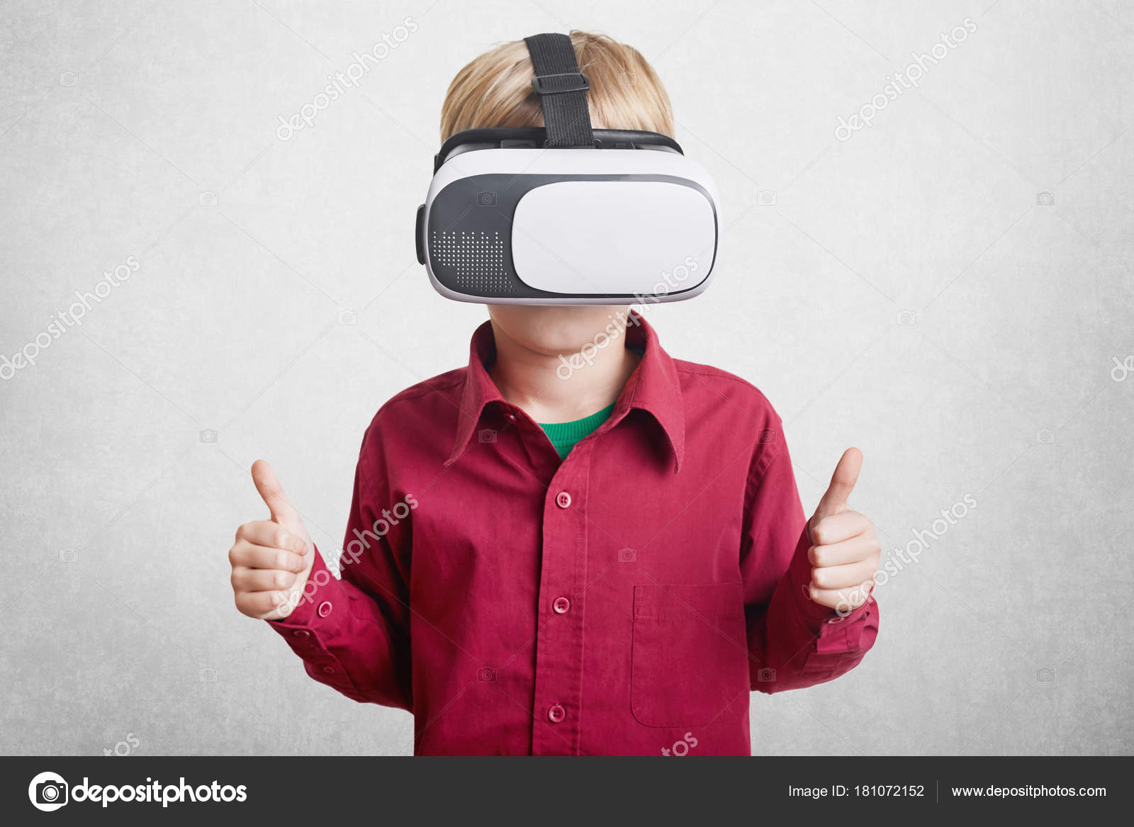 1097226c4a35 Pleased small boy enjoys virtual reality
