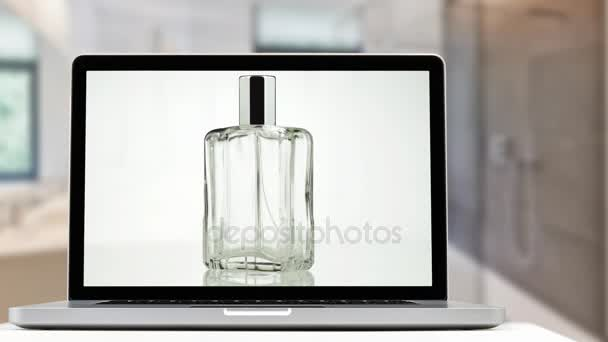 Cinemagraph- Laptop with a bottle of perfume in 360 degrees movement