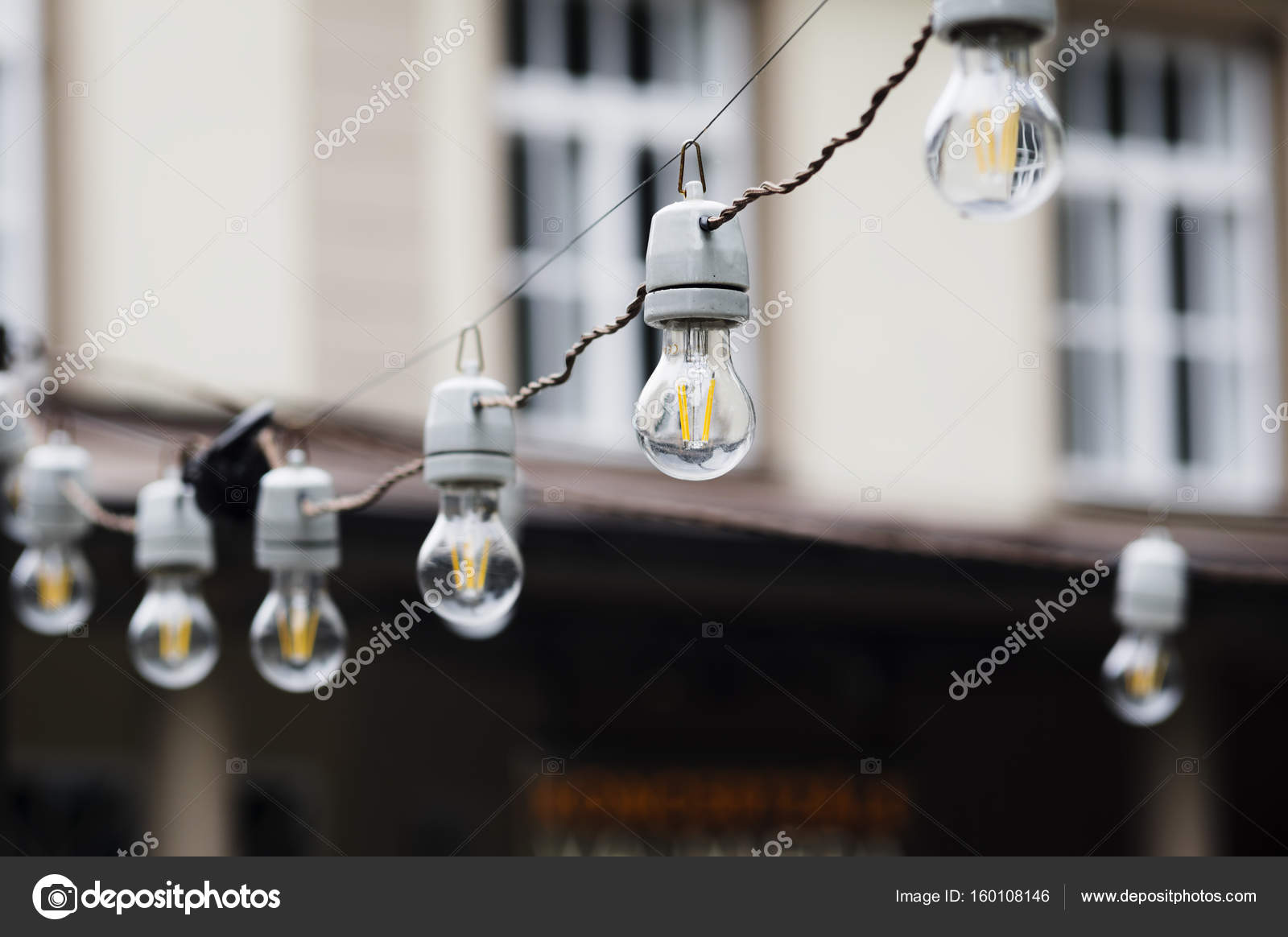 Decorative outdoor string lights stock photo nevada31 160108146 decorative outdoor string lights hanging photo by nevada31 aloadofball Choice Image
