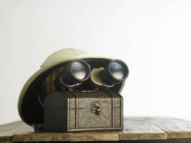Old colonial hat and binoculars