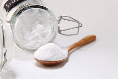 baking soda in jar and spoon