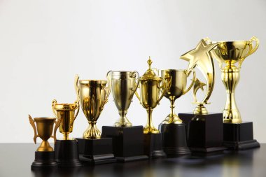 different golden trophies