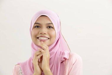malay woman with tudung sitting facing camera