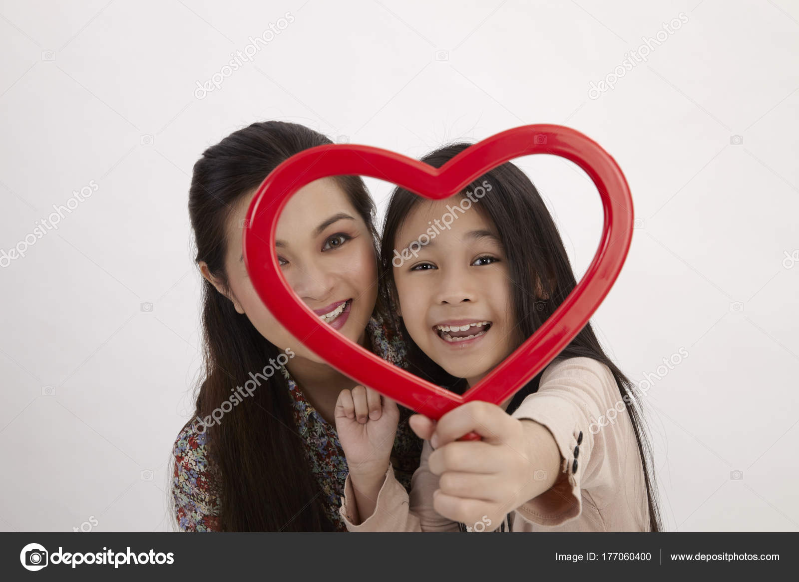 Malay Mother Daughter Holding Red Heart Shape Picture Frame Facing