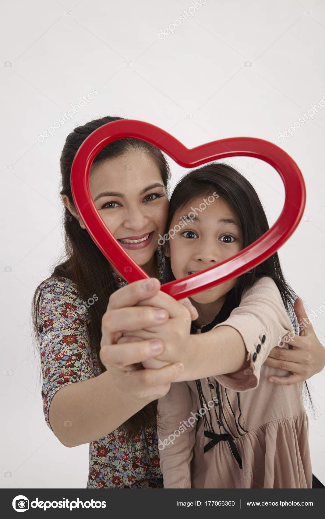 Malay Mother Daughter Holding Red Heart Shape Picture Frame Facing ...