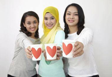 focus on the cup of love which hold by malaysian women