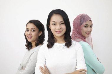 Malaysian three multi racial looking at camera