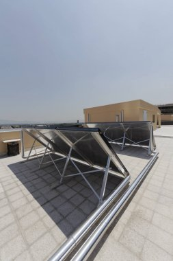 Italy, Rome, photovoltaic solar panels on the roof of a building
