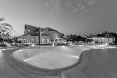 Italy, Sicily, Modica (Ragusa Province); 4 July 2011, Hotel's swimming pool area at sunset - EDITORIAL