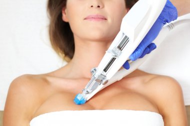 woman having breast mesotherapy