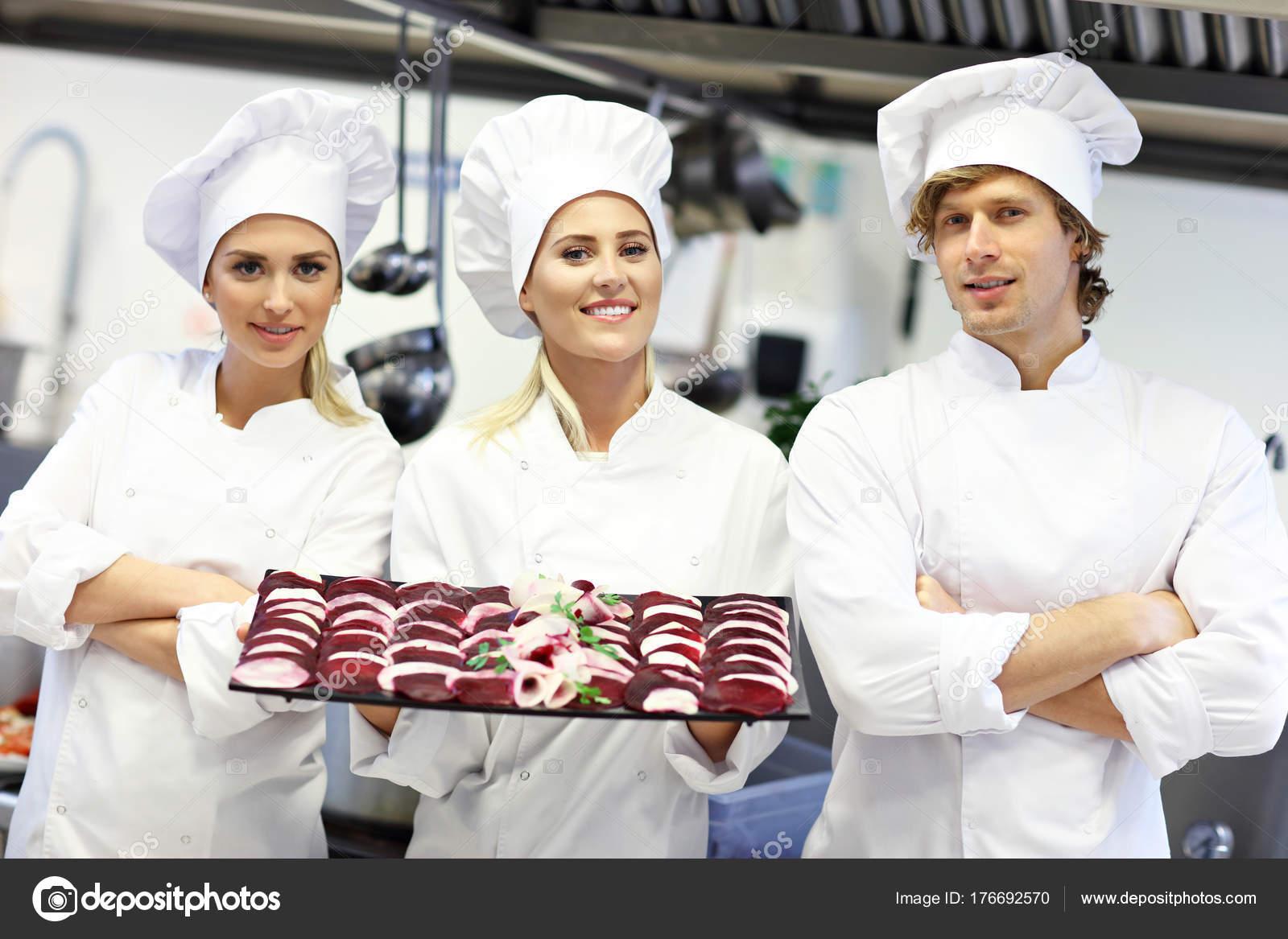 busy restaurant kitchen. Busy Chefs At Work In The Restaurant Kitchen \u2014 Stock Photo