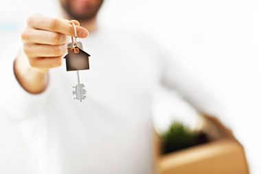 Picture showing happy adult couple moving out or in to new home