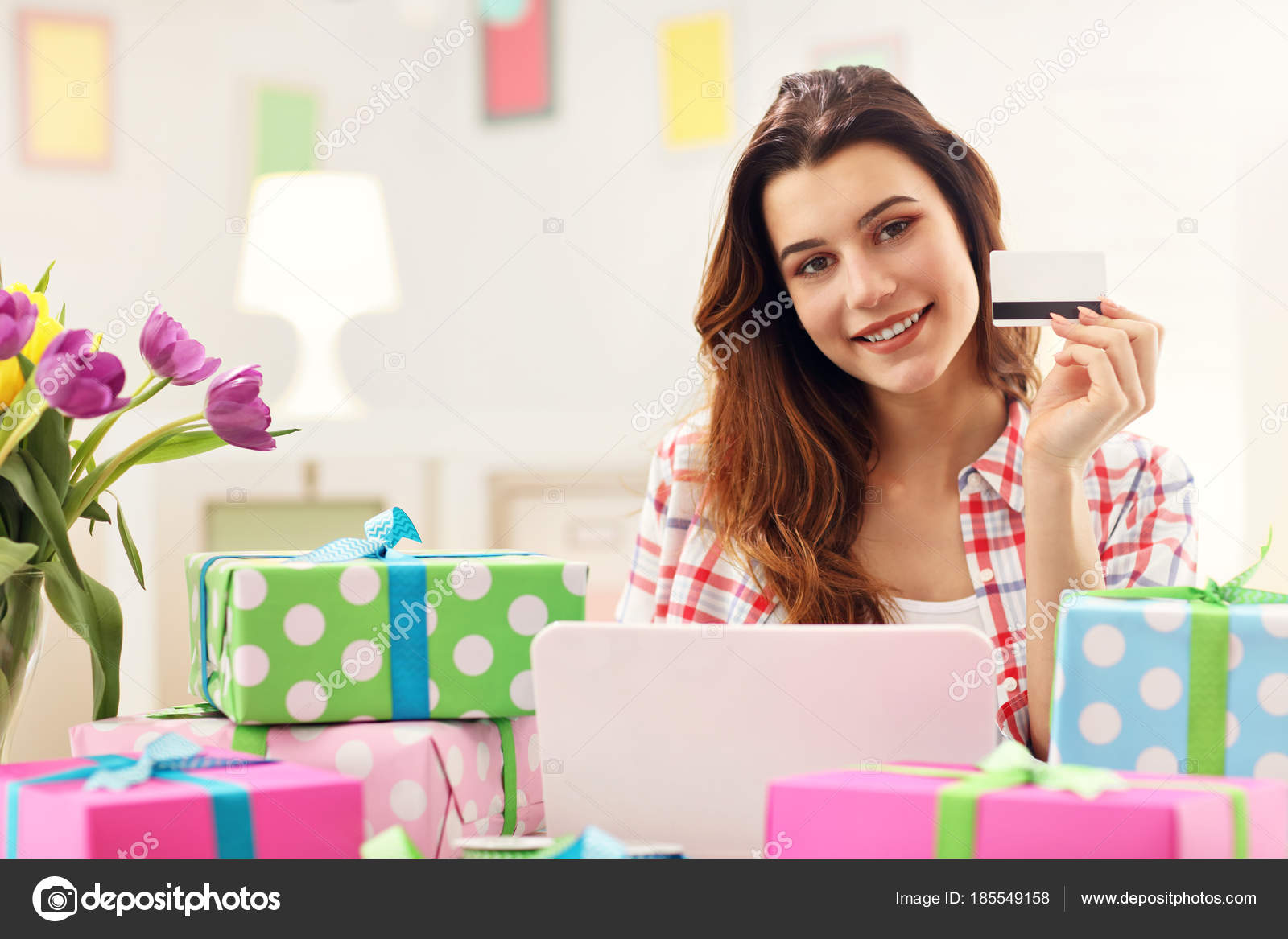 Attractive woman buying easter gifts online stock photo macniak attractive woman buying easter gifts online stock photo negle Images