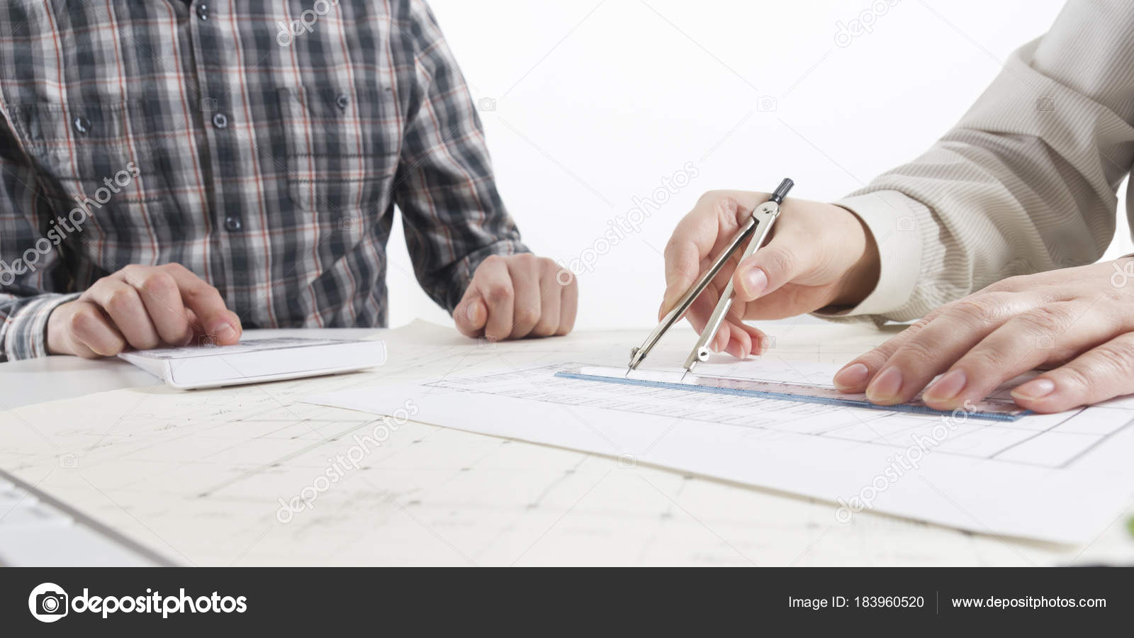 Architects working on blueprint real estate project architect architects working on blueprint real estate project architect workplace architectural project blueprints malvernweather