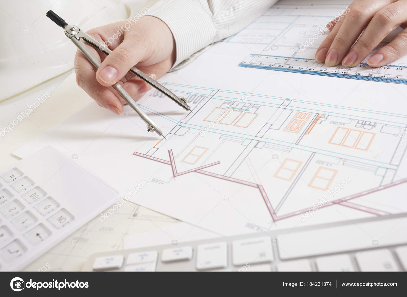 Architects working on blueprint real estate project architect architects working on blueprint real estate project architect workplace architectural project blueprints malvernweather Images