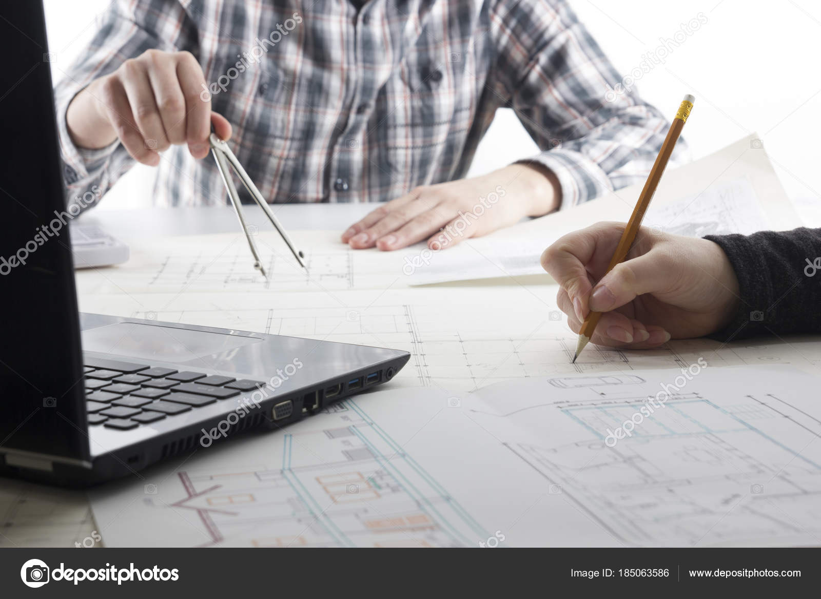 Architects working on blueprint real estate project architect architects working on blueprint architects workplace architectural project blueprints ruler calculator laptop and divider compass construction malvernweather Image collections