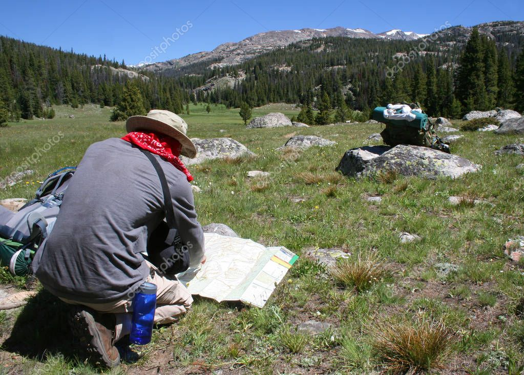 Hiker navigates using map