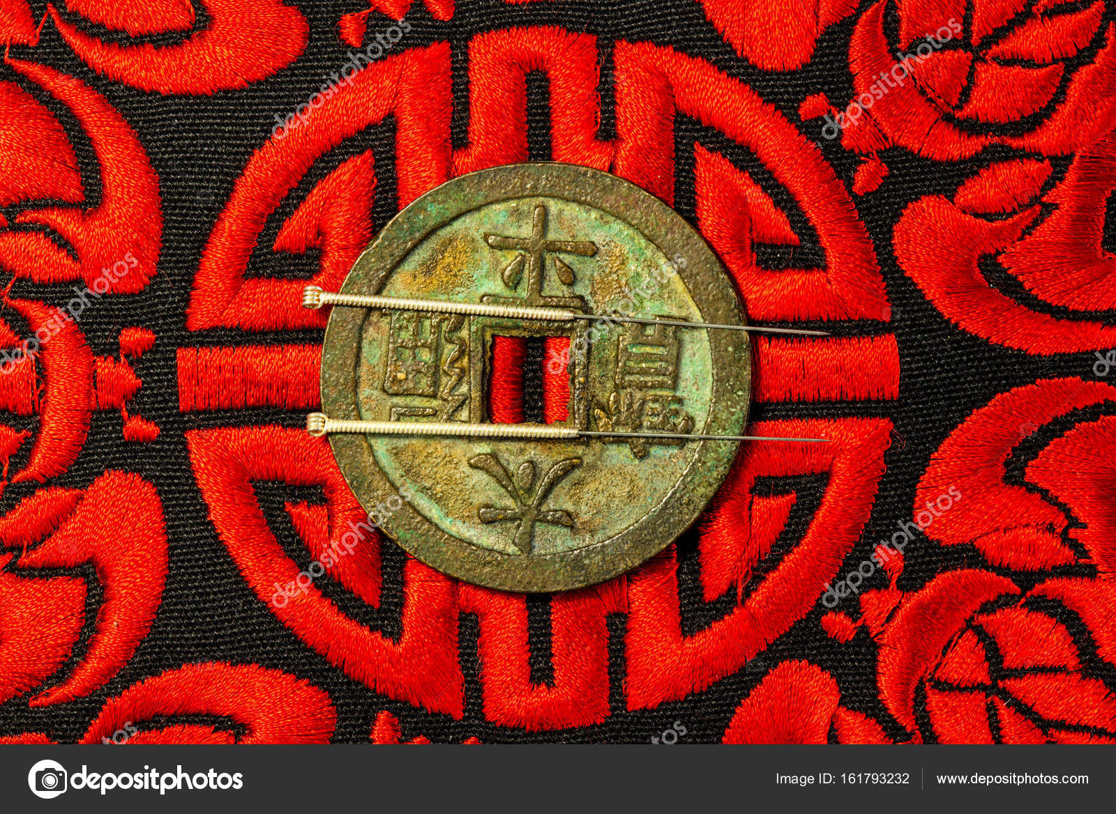Acupuncture Needles On Chinese Coin And Symbol For Immortality