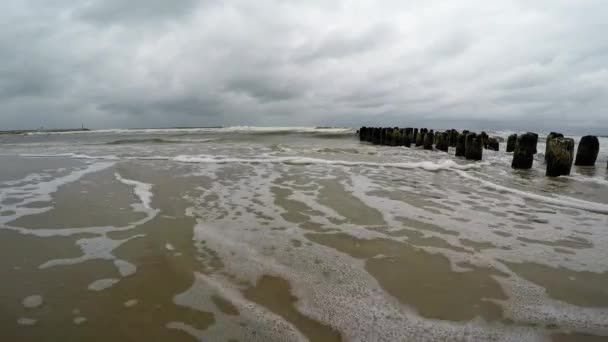 Surf of the Baltic Sea in Poland, camera in the surf
