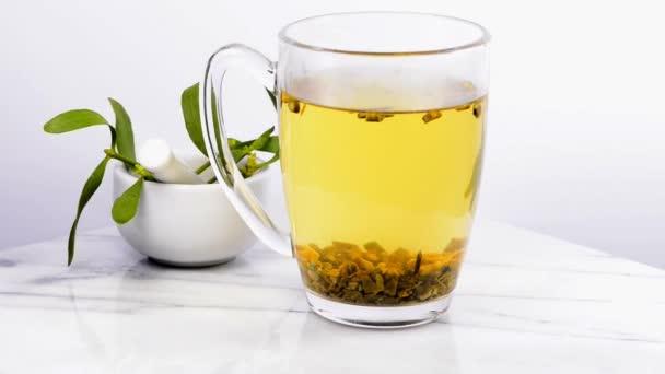 Mistletoe, tea on a turn table