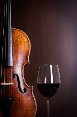 Violin waist detail with glass of wine
