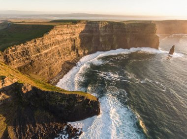 Cliffs of Moher sunset and castle Ireland