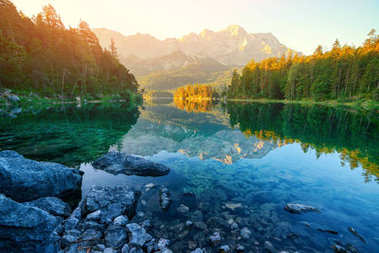 Fantastic sunrise on mountain lake Eibsee