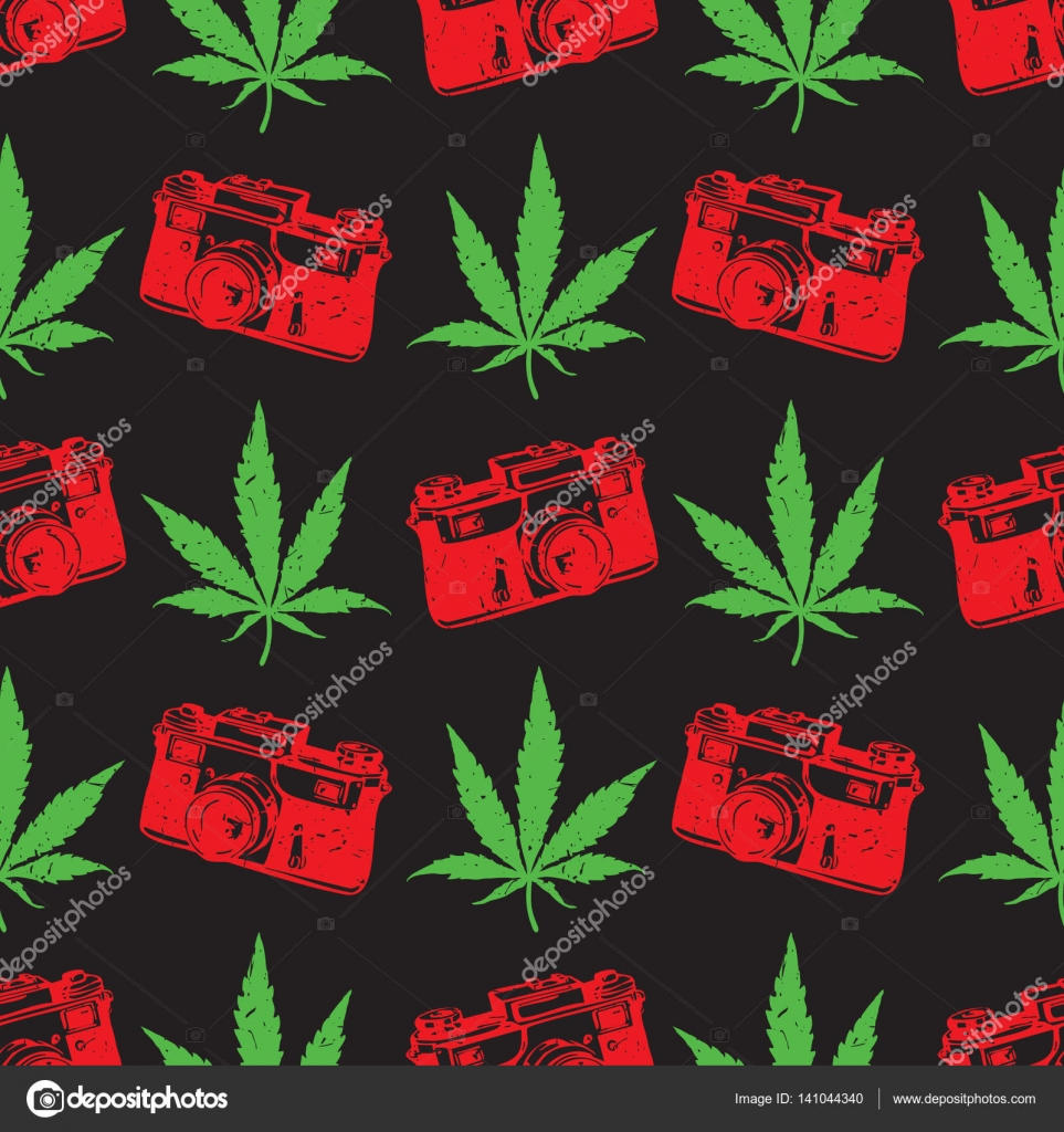 Decorative seamless pattern with green and red marijuana leaves and ...