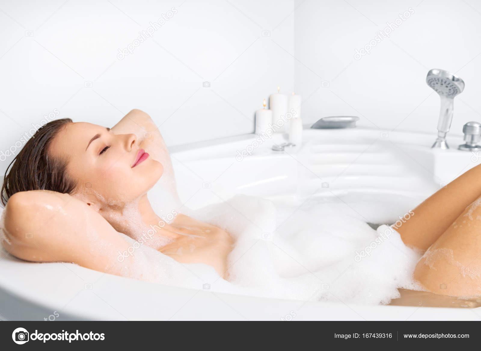 Young woman enjoying bathing in bathtub — Stock Photo © Avesun ...