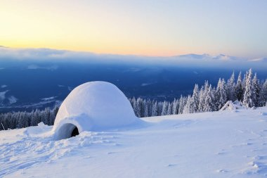 Big round igloo stands on mountains.
