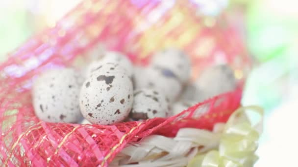 Basket with Easter eggs and hand on grass background