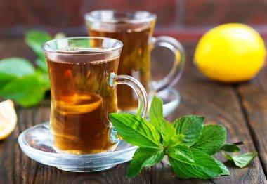 lemon tea in cups