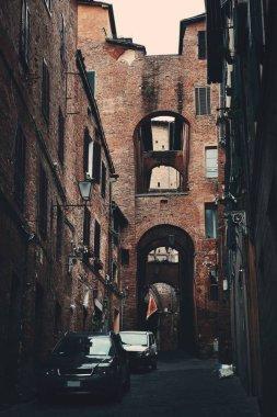 """Картина, постер, плакат, фотообои """"street view with old buildings and archway in siena, italy."""", артикул 193136612"""