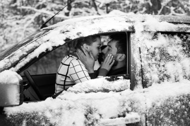 couple sitting inside car