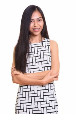 Young happy Asian teenage girl smiling with arms crossed