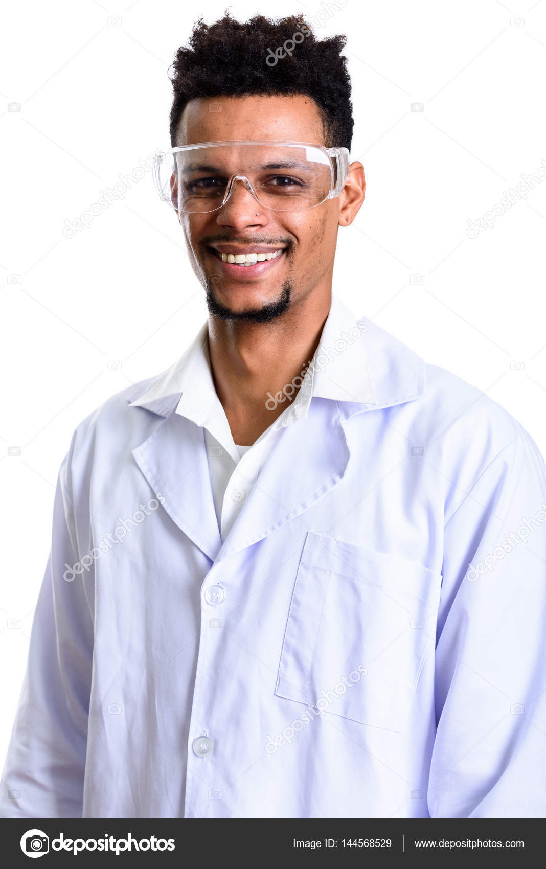 2cc8432d0130 Studio shot of young happy African man doctor smiling while wearing  protective glasses — Photo by ...