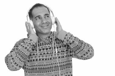 Mature happy Persian man listening to music