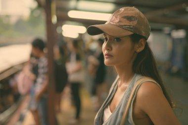 Young beautiful Asian tourist woman exploring the city of Bangkok, Thailand