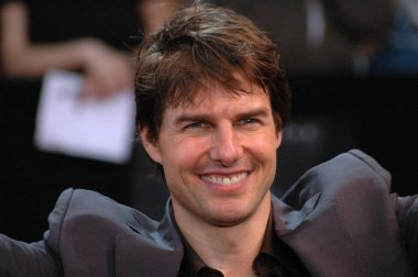 Tom Cruise looks into the camera