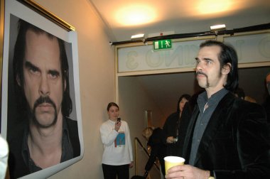 Nick Cave looks at portrait of himself