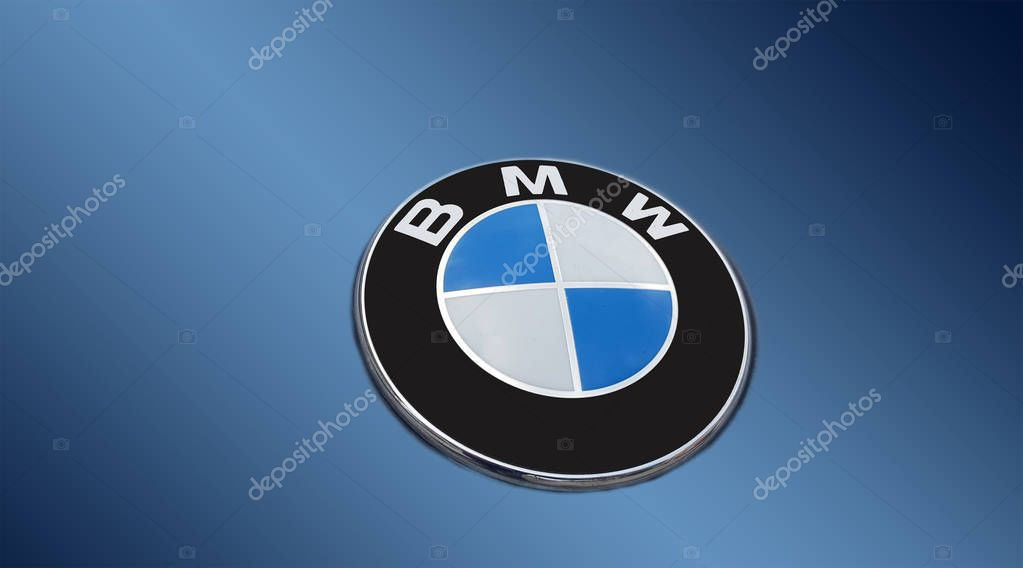 Detail of the vent of a BMW logo on blue