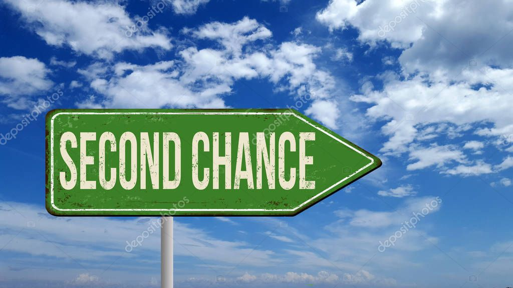 Second chance metallic vintage sign over blue sky with clouds