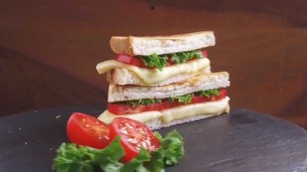fried toast with cheese and tomato on a stone surface rotate
