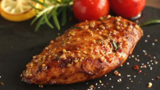 cooking fried roasted chicken breasts cut knife with lemon tomato and rosemary mustard seeds honey