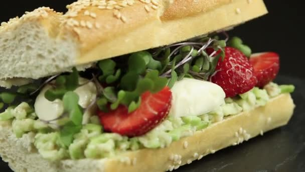 sandwich baguette with strawberries mozzarella cheese guacamole close up