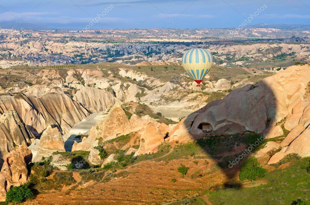Colorful hot air balloon flies in Cappadocia region, Turkey