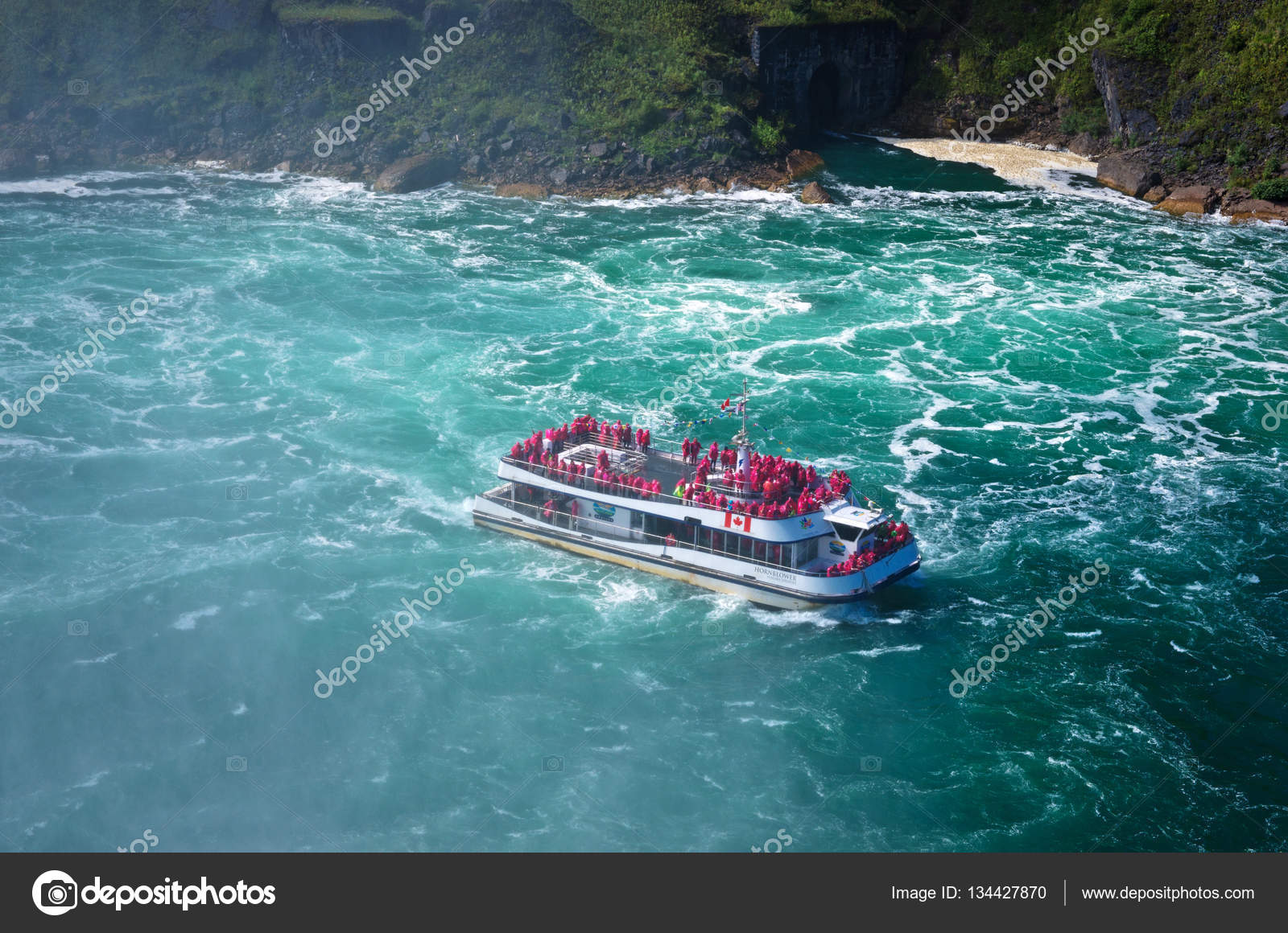 Boat Hornblower with tourists at waterfall. – Stock Editorial Photo © Byelikova #134427870
