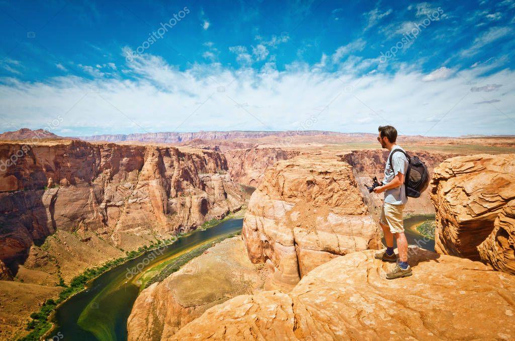 Man look at Horseshoe Bend