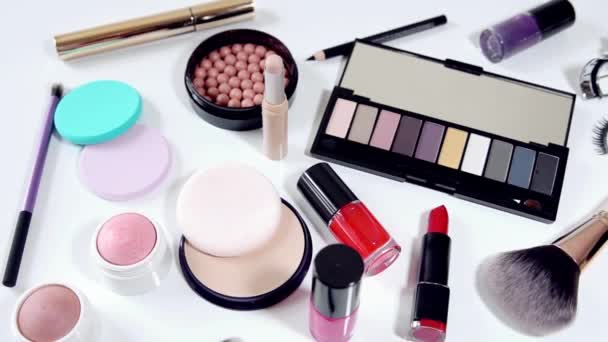 collection of makeup cosmetics on white background